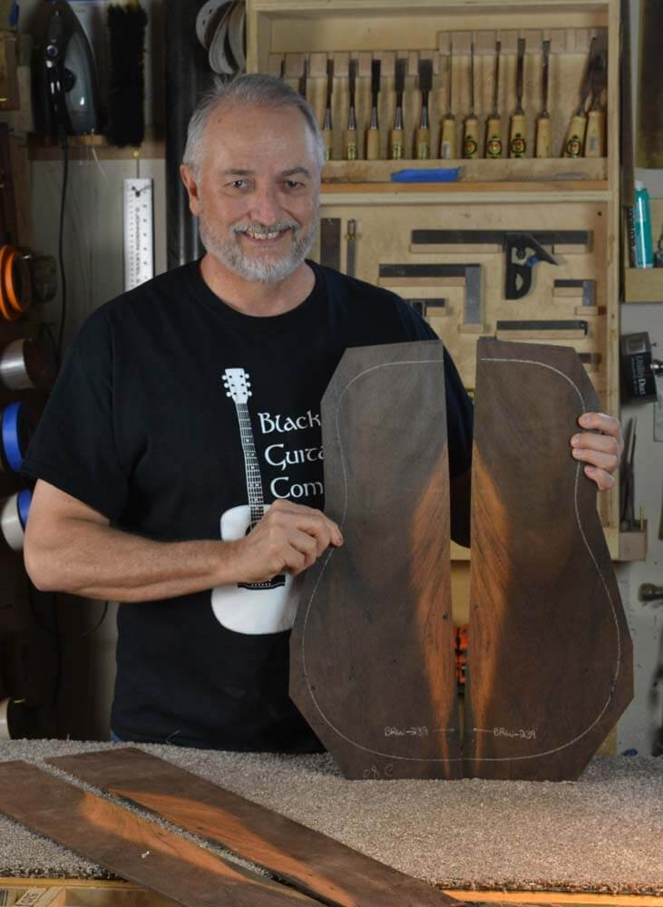 Custom guitars offer the buyer a wide variety of incredible woods to choose from. In this photo I am holding a spectacular set of Brazilian rosewood with a ''winged'' pattern on both the back and sides. Players can select wood from my extensive inventory to get the right grain, colour, sound and weight.