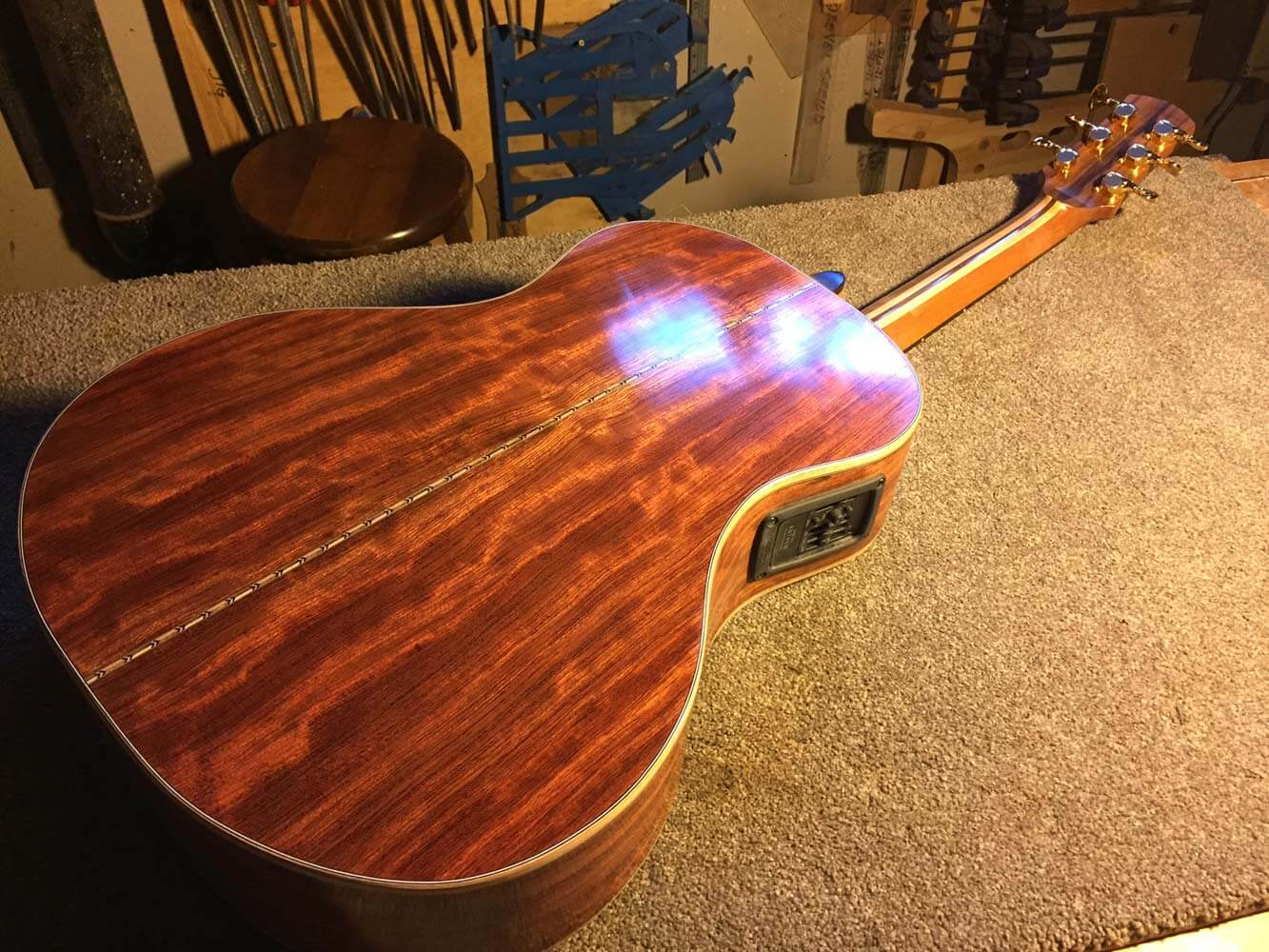 This guitar is almost complete. The wood is a stunning ''waterfall'' African Bubinga. The guitar was a custom size for a professional, but petite player.